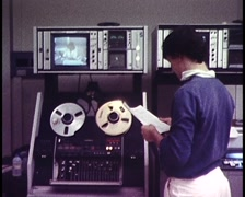 VIDEOTAPE OPERATOR / REEL TO REEL VIDEO AT TV STATION Stock Footage