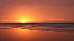 Orange beach sunrise Stock Footage