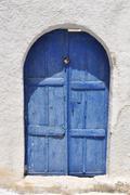 classical blue greek wooden door, santorini - stock photo