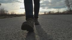 Feet. Boots. Girl Walking Along The Road. Steadicam - stock footage