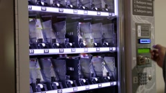 Buying products in vending machine Stock Footage