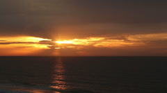 Cloud filtered sunrise over the ocean Stock Footage