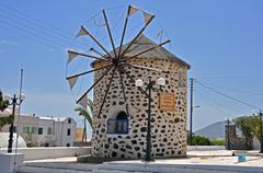 Old restored windmill on greek island Santorini Stock Photos