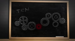 Cogs and wheels turning on blackboard - stock footage