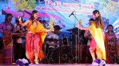 2 Students dance a traditional dance at Songkran,Ubon Ratchathani,Thailand Stock Footage