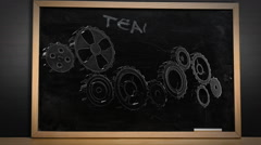Cogs and wheels turning on blackboard Stock Footage