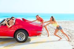 Car pushing teen girls humor funny guy driving Stock Photos