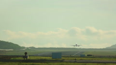 Jet airplane touch down the runway Stock Footage