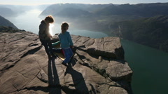 Family on Preikestolen massive cliff top (Norway) Stock Footage