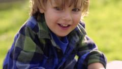 Little Boy Plays On A Park Bench Stock Footage