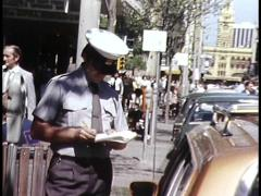 PARKING INSPECTOR WRITES TICKETS / INSPECTS CARS Stock Footage