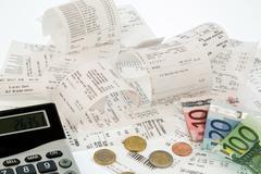 calculator, receipts, bills - stock photo