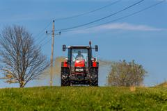 Tractor fertilized with manure a field Stock Photos