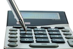 Stock Photo of red pen and calculator