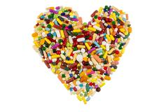 Colorful tablets in heart shape Stock Photos