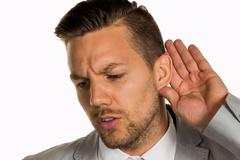 Stock Photo of man listening to