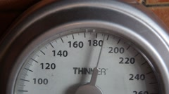 Analog weight scale measuring 180 pounds - stock footage