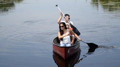 Mom Dad and girl in canoe 3 - stock footage