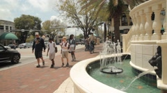 Busy Coco Walk Miami Street, with waterfall in foreground Stock Footage