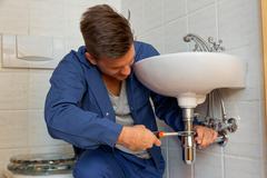 plumber at work - stock photo
