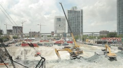 Construction in Downtown Miami, Metro Rail passes by in the background Stock Footage