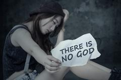 Depressed girl is not trust in GOD - stock photo