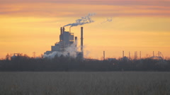 Factory Emissions with Nature in Foreground Stock Footage