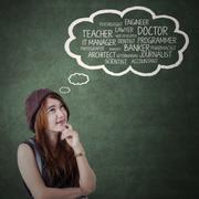 Female teenager imagine her future job - stock photo