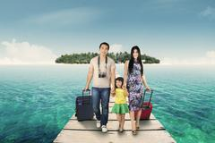 Family arriving at the resort island - stock photo