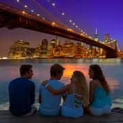 Friends group rear view at sunset fun New York - stock photo