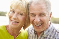 Head And Shoulders Portrait Of Senior Couple Outdoors Stock Photos