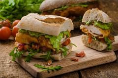 Veal schnitzel - fillet in a bun - stock photo