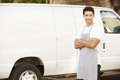 Man Wearing Apron Standing In Front Of Van Stock Photos