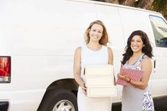 Two Women Running Catering Business With Van Stock Photos