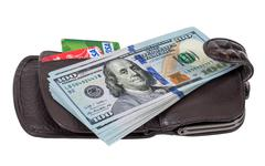 Wallet with american dollars and credit cards, isolated on white - stock photo