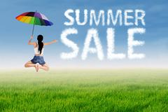 Summer sale clouds with a woman Stock Photos