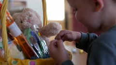 A little boy with his easter basket in the morning Stock Footage