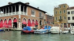 Open-air vendors along the Grand Canal in Venice, Italy Stock Footage