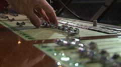 Audio mixer: fingers sliding controls Stock Footage