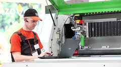 Industrial machine operator in uniform on working place Stock Footage