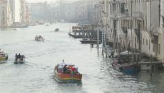 Transportation boats along water canal in italian town of Venice Stock Footage