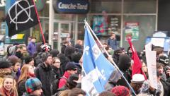 1080p 24fps - Masked anarchists protesters walking with flag - stock footage