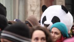 1080p 24fps - Anarcho Panda walks and protests in large crowd Stock Footage