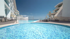 Hotel small swimming pool with sunny reflections timelapse, Sesimbra, Portugal Stock Footage
