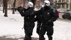 1080p 24fps - Riot unit gets snow balls thrown at them - HD 1080p Stock Footage