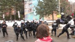 1080p 24fps - Riot officer uses baton to push away protesters - HD 1080p Stock Footage
