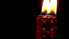 Flaming dice fire black background red gamble heat hot flame dramatic poker game Stock Footage