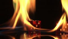 flaming rolling dice fire black background red blue gamble slow motion - stock footage