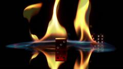 Stock Video Footage of slow motion rolling dice fire black background red blue gamble risky