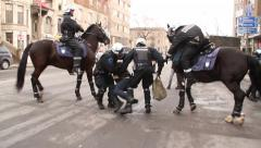 1080p 24fps - Policeman in riot gear drags rioter on the ground with horses Stock Footage